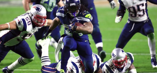 Feb 1, 2015; Glendale, AZ, USA; Seattle Seahawks running back Marshawn Lynch (24) carries the ball past New England Patriots defensive tackle Vince Wilfork (75) and Rob Ninkovich (50) during the third quarter in Super Bowl XLIX at University of Phoenix Stadium. Mandatory Credit: Andrew Weber-USA TODAY Sports ORG XMIT: USATSI-185920 ORIG FILE ID:  20150201_rvr_aw3_183.jpg
